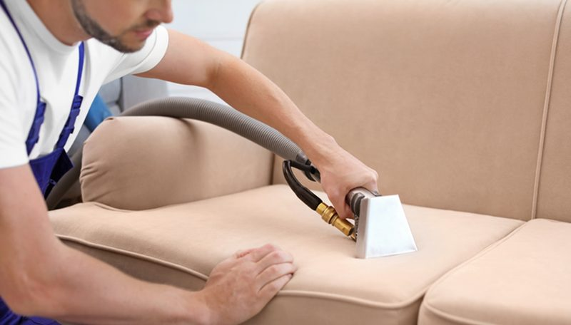 Sofa being cleaned
